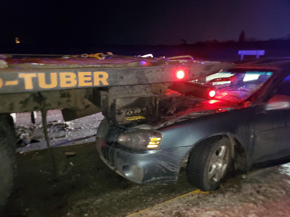 Car Under Tow Truck