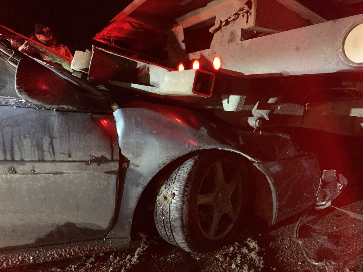 Car under truck